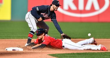 Apr 20, 2019; Cleveland, OH, USA; Cleveland Indians shortstop Max Moroff (26) steals second as Atlanta Braves shortstop Dansby Swanson (7) waits for the throw during the second inning at Progressive Field. Mandatory Credit: Ken Blaze-USA TODAY Sports