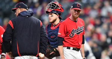 Apr 21, 2019; Cleveland, OH, USA; Cleveland Indians starting pitcher Shane Bieber (57) leaves the mound after being relieved by Cleveland Indians manager Terry Francona (left) during the third inning against the Atlanta Braves at Progressive Field. Mandat