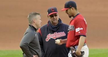 Apr 23, 2019; Cleveland, OH, USA; Cleveland Indians manager Terry Francona (middle) talks with starting pitcher Carlos Carrasco (59) after Carrasco was involved in a collision at first base in the fourth inning against the Miami Marlins at Progressive Fie