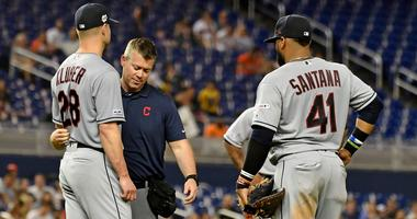 May 1, 2019; Miami, FL, USA; A member of the Cleveland Indians medical staff checks on starting pitcher Corey Kluber (28) after he was struck in the arm by a ball in the fifth inning H\ at Marlins Park. Mandatory Credit: Jasen Vinlove-USA TODAY Sports