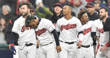 Cleveland Indians pinch hitter Tyler Naquin (left) and shortstop Francisco Lindor celebrate after Naquin's walk off RBI single during the ninth inning against the Seattle Mariners at Progressive Field.