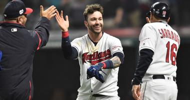 May 3, 2019; Cleveland, OH, USA; Cleveland Indians pinch hitter Tyler Naquin (center) celebrates after his game winning RBI single against the Seattle Mariners at Progressive Field. Mandatory Credit: Ken Blaze-USA TODAY Sports