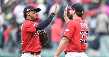May 4, 2019; Cleveland, OH, USA; Cleveland Indians shortstop Francisco Lindor (12) and relief pitcher Brad Hand (33) celebrate after the Indians beat the Seattle Mariners at Progressive Field. Mandatory Credit: Ken Blaze-USA TODAY Sports