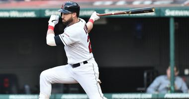 May 6, 2019; Cleveland, OH, USA; Cleveland Indians second baseman Jason Kipnis (22) hits an RBI single during the fifth inning against the Chicago White Sox at Progressive Field. Mandatory Credit: Ken Blaze-USA TODAY Sports