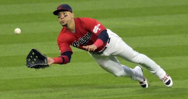 May 8, 2019; Cleveland, OH, USA; Cleveland Indians left fielder Carlos Gonzalez (24) makes a diving catch in the eighth inning against the Chicago White Sox at Progressive Field. Mandatory Credit: David Richard-USA TODAY Sports