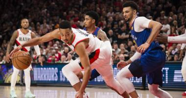 Portland Trail Blazers guard CJ McCollum (3) drives around Denver Nuggets guard Jamal Murray (27) during the second half in game six of the second round of the 2019 NBA Playoffs at Moda Center. The Trail Blazers beat the Nuggets 119-108.