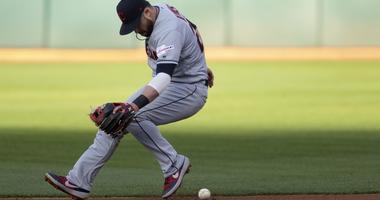 Cleveland Indians second baseman Jason Kipnis (22) fields a ball hit by Oakland Athletics Jurickson Profar during the first inning of a Major League Baseball game at Oakland Coliseum.