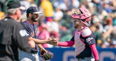 May 12, 2019; Oakland, CA, USA; Cleveland Indians relief pitcher Brad Hand (33) celebrates with Cleveland Indians catcher Roberto Perez (55) after the end of the game against the Oakland Athletics at Oakland Coliseum. Mandatory Credit: Neville E. Guard-US