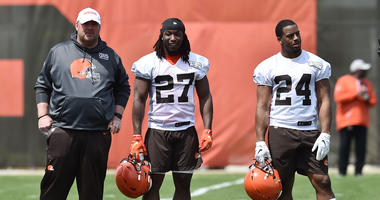 May 15, 2019; Berea, OH, USA; Cleveland Browns head coach Freddie Kitchens (left) and running back Kareem Hunt (27) and running back Nick Chubb (24) during organized team activities at the Cleveland Browns training facility. Mandatory Credit: Ken Blaze-US