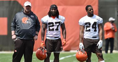 Cleveland Browns head coach Freddie Kitchens (left) and running back Kareem Hunt (27) and running back Nick Chubb (24) during organized team activities at the Cleveland Browns training facility.