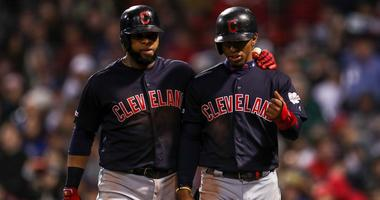 May 29, 2019; Boston, MA, USA; Cleveland Indians first baseman Carlos Santana (41) and shortstop Francisco Lindor (12) react after scoring during the sixth inning against the Boston Red Sox at Fenway Park. Mandatory Credit: Paul Rutherford-USA TODAY Sport