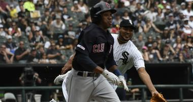 Jun 1, 2019; Chicago, IL, USA; Chicago White Sox starting pitcher Ivan Nova (46) tries to throw out Cleveland Indians left fielder Greg Allen (1) as he beats out an infield single during the fifth inning at Guaranteed Rate Field. Mandatory Credit: David B