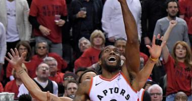 Toronto Raptors forward Kawhi Leonard (2) shoots the ball against Golden State Warriors guard Stephen Curry (30) in game two of the 2019 NBA Finals at Scotiabank Arena.
