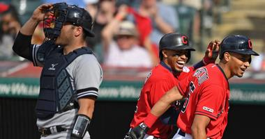 Cleveland Indians left fielder Oscar Mercado (35) celebrates with short stop Francisco LIndor after hitting a two run home run of New York Yankees starting pitcher CC Sabathia (not pictured) in the fifth inning at Progressive Field