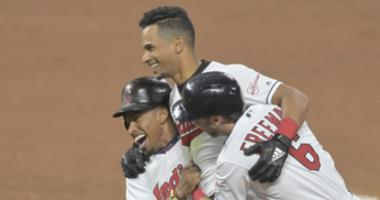 Jun 11, 2019; Cleveland, OH, USA; Cleveland Indians left fielder Oscar Mercado (35), center, celebrates his game-winning single with shortstop Francisco Lindor (12) and second baseman Mike Freeman (6) in the tenth inning against the Cincinnati Reds at Pro