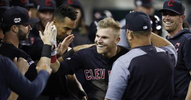 Jun 14, 2019; Detroit, MI, USA; Cleveland Indians left fielder Jake Bauers (10) celebrates with teammates in the dugout after hitting a two run home run against the Detroit Tigers during the eighth inning at Comerica Park. Mandatory Credit: Raj Mehta-USA