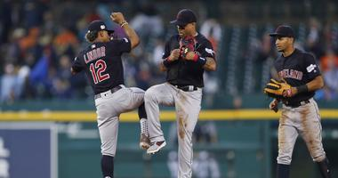Cleveland Indians center fielder Leonys Martin (2) celebrates with shortstop Francisco Lindor (12) after the game against the Detroit Tigers at Comerica Park.