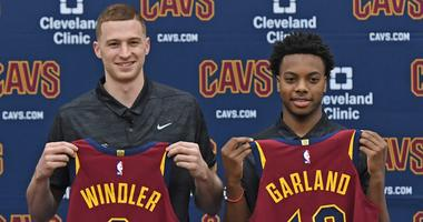 Jun 21, 2019; Independence, OH, USA; Cleveland Cavaliers first round draft picks Dylan Windler, left, and Darius Garland show off their jerseys during a press conference at Cleveland Clinic Courts. Mandatory Credit: David Dermer-USA TODAY Sports