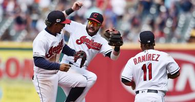 Jun 23, 2019; Cleveland, OH, USA; Cleveland Indians shortstop Francisco Lindor (12) and second baseman Jason Kipnis (22) and third baseman Jose Ramirez (11) celebrate after defeating the Detroit Tigers at Progressive Field. Mandatory Credit: Ken Blaze-USA