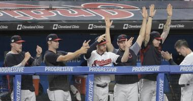 Jun 24, 2019; Cleveland, OH, USA; Players in the Cleveland Indians dugout celebrate in the sixth inning against the Kansas City Royals at Progressive Field. Mandatory Credit: David Richard-USA TODAY Sports
