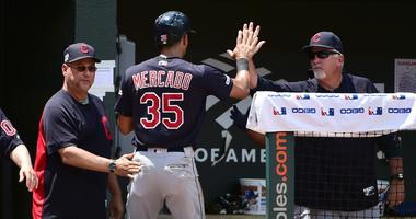 Cleveland Indians manager Terry Francona (left) congratulates outfielder Oscar Mercado (35) after scoring a run in the third inning against the Baltimore Orioles at Oriole Park at Camden Yards.