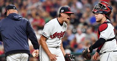 Jul 13, 2019; Cleveland, OH, USA; Cleveland Indians relief pitcher Tyler Clippard (36) reacts after giving up two runs and being relieved in the eighth inning by Cleveland Indians manager Terry Francona against the Minnesota Twins at Progressive Field.
