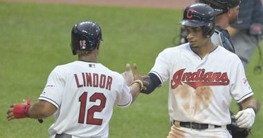 Jul 16, 2019; Cleveland, OH, USA; Cleveland Indians center fielder Oscar Mercado (35) celebrates with shortstop Francisco Lindor (12) after hitting a two run home run in the second inning against the Detroit Tigers at Progressive Field. Mandatory Credit: