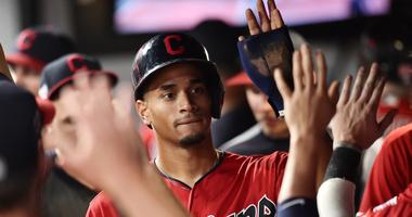 Cleveland Indians center fielder Oscar Mercado (35) celebrates after scoring during the eighth inning against the Kansas City Royals at Progressive Field.