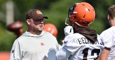 Cleveland Browns head coach Freddie Kitchens talks with wide receiver Odell Beckham (13) during training camp at the Cleveland Browns Training Complex.
