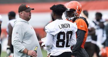 Cleveland Browns head coach Freddie Kitchens talks with wide receiver Jarvis Landry (80) and quarterback Baker Mayfield (6) during training camp at the Cleveland Browns Training Complex.