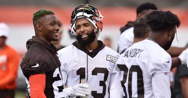 Cleveland Browns strong safety Damarious Randall (23) talks with wide receiver Odell Beckham (13) during training camp at the Cleveland Browns Training Complex