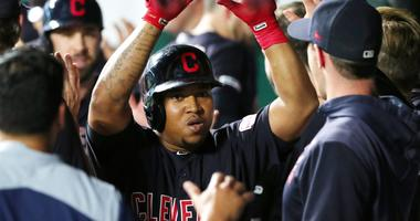 Cleveland Indians designated hitter Jose Ramirez (11) is congratulated after hitting a home run against the Kansas City Royals during the sixth inning at Kauffman Stadium.