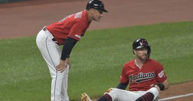 Aug 5, 2019; Cleveland, OH, USA; Cleveland Indians left fielder Jordan Luplow (8) reacts beside third base coach Mike Sarbaugh (16) after he was injured while stealing third base in the seventh inning against the Texas Rangers leat Progressive Field. Mand