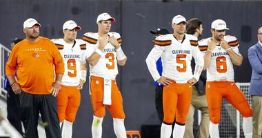 Cleveland Browns head coach Freddie Kitchens stands on the sidelines with quarterbacks David Blough (9), Garrett Gilbert (3), Drew Stanton (5) and Baker Mayfield (6)