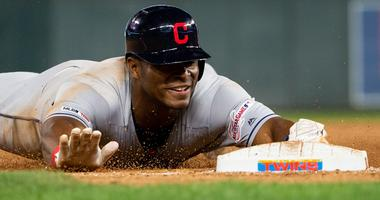 Aug 9, 2019; Minneapolis, MN, USA; Cleveland Indians outfielder Yasiel Puig (66) slides into third in the ninth inning against Minnesota Twins at Target Field. Mandatory Credit: Brad Rempel-USA TODAY Sports
