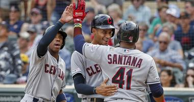 Aug 11, 2019; Minneapolis, MN, USA; Cleveland Indians first baseman Carlos Santana (41) celebrates with center fielder Greg Allen (1) and pinch runner Oscar Mercado (35) after hitting a grand slam against the Minnesota Twins in the tenth inning at Target