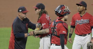 Aug 13, 2019; Cleveland, OH, USA; Cleveland Indians manager Terry Francona (77) takes the ball from starting pitcher Mike Clevinger (52) during a pitching change in the fifth inning against the Boston Red Sox at Progressive Field. Mandatory Credit: David