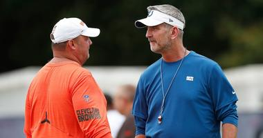Indianapolis Colts head coach Frank Reich talks with Cleveland Browns head coach Freddie Kitchens during their preseason training camp practice at Grand Park in Westfield on Wednesday, August 14, 2019. Colts Preseason Training Camp