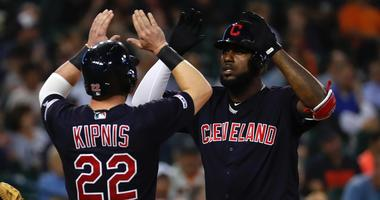 Aug 27, 2019; Detroit, MI, USA; Cleveland Indians right fielder Franmil Reyes (32) receives congratulations from second baseman Jason Kipnis (22) after his two run home run in the seventh inning against the Detroit Tigers at Comerica Park. Mandatory Credi