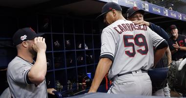 Cleveland Indians manager Terry Francona (77) hugs pitcher Carlos Carrasco (59) after he pitched the seventh inning for the first time since he was diagnosed with leukemia against the Tampa Bay Rays at Tropicana Field.