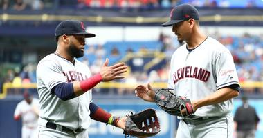 Cleveland Indians first baseman Carlos Santana (left) and pitcher Carlos Carrasco (right)