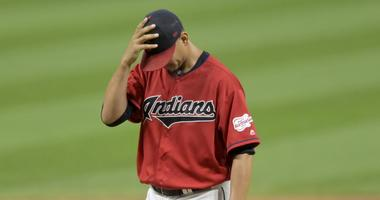 Sep 3, 2019; Cleveland, OH, USA; Cleveland Indians relief pitcher Carlos Carrasco (59) reacts after giving up a three run home run against the Chicago White Sox in the eighth inning at Progressive Field. Mandatory Credit: David Richard-USA TODAY Sports