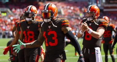 Cleveland Browns wide recievers Odell Beckham (13) and Damion Ratley (18) along with quarterback Baker Mayfield (6) welcome teammates onto the field during warmups before a game against the Tennessee Titans at FirstEnergy Stadium.