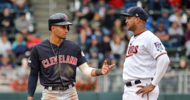 Sep 8, 2019; Minneapolis, MN, USA; Cleveland Indians center fielder Oscar Mercado (35) talks with Minnesota Twins second baseman Jonathan Schoop (16) after hitting a double during the ninth inning at Target Field. Mandatory Credit: Jeffrey Becker-USA TODA
