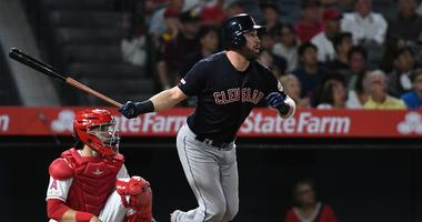Sep 9, 2019; Anaheim, CA, USA; Cleveland Indians second baseman Jason Kipnis (22) hits a two run home run against the Los Angeles Angels in the second inning at Angel Stadium of Anaheim. Mandatory Credit: Richard Mackson-USA TODAY Sports
