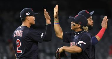 Sep 9, 2019; Anaheim, CA, USA; Cleveland Indians shortstop Francisco Lindor (12) and shortstop Yu Chang (2) celebrate after defeating the Los Angeles Angels at Angel Stadium of Anaheim. Mandatory Credit: Richard Mackson-USA TODAY Sports