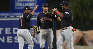 Sep 9, 2019; Anaheim, CA, USA; Cleveland Indians left fielder Greg Allen (1) and center fielder Oscar Mercado (35) and right fielder Yasiel Puig (66) celebrate after defeating the Los Angeles Angels at Angel Stadium of Anaheim. Mandatory Credit: Richard M