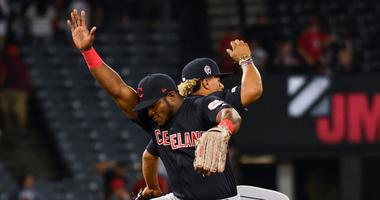 Sep 11, 2019; Anaheim, CA, USA; Cleveland Indians right fielder Yasiel Puig (left) and Indians shortstop Francisco Lindor (right) celebrate after defeating the Los Angeles Angels at Angel Stadium of Anaheim. Mandatory Credit: Robert Hanashiro-USA TODAY Sp