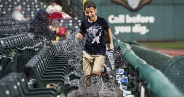 Sep 13, 2019; Cleveland, OH, USA; A young fan runs through the water in the stands during a rain delay in the third inning of the game between the Cleveland Indians and the Minnesota Twins at Progressive Field. Mandatory Credit: Ken Blaze-USA TODAY Sports