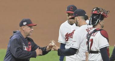 Sep 14, 2019; Cleveland, OH, USA; Cleveland Indians manager Terry Francona (77) takes the ball from Cleveland Indians relief pitcher Oliver Perez (39) during a pitching change in the eighth inning against the Minnesota Twins at Progressive Field. Mandator